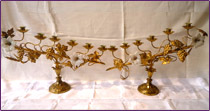 A pair of candelabra for  six lights in bronze, decorated with leaves and bunches of grapes