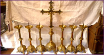 Altar cross and its six  candlesticks in bronze of the 19th century